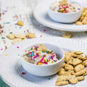 Side view of two servings of the dip on plates with cookies.