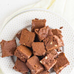 Overhead view of a plate of fudge with a text overlay for pinterest.