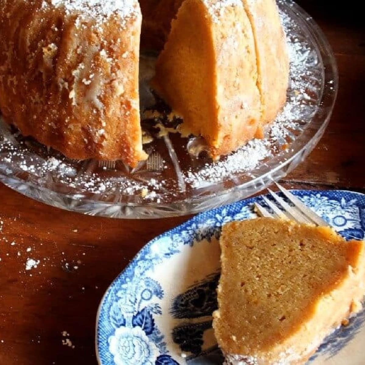 A sweet potato pound cake with a slice removed showing the velvety interior.